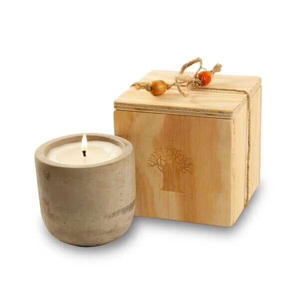 candle in raw cement holder packed in wooden box
